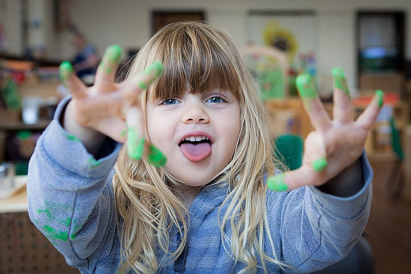 Photo of one of our children enjoying finger painting!